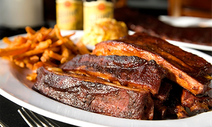 ON Q Smokehouse Grill - St. Leo: Barbecue for Two or Four at ON Q Smokehouse Grill (Half Off)