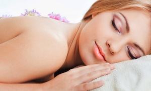 Joy Wilkins Massage Therapy: Massage and Facial or Winter Wonderland Package at Joy Wilkins Massage Therapy (Up to 60% Off)
