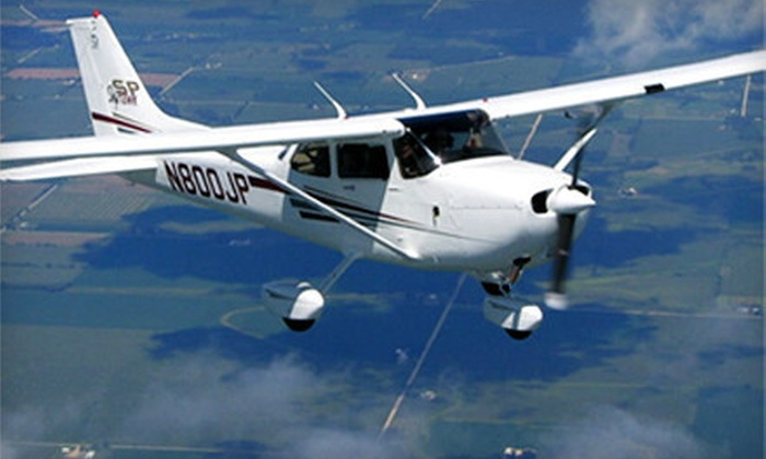 Hayward Flight - Hayward: Flight-Simulator Package, Flight-Lesson Package, or Bay Plane Tour for Three from Hayward Flight (Up to 51% Off)