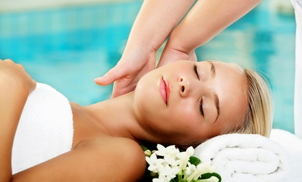 Non-Surgical Microcurrent Facelift or 60-Minute AromaTouch Massage at Room Too (Up to 65% Off)