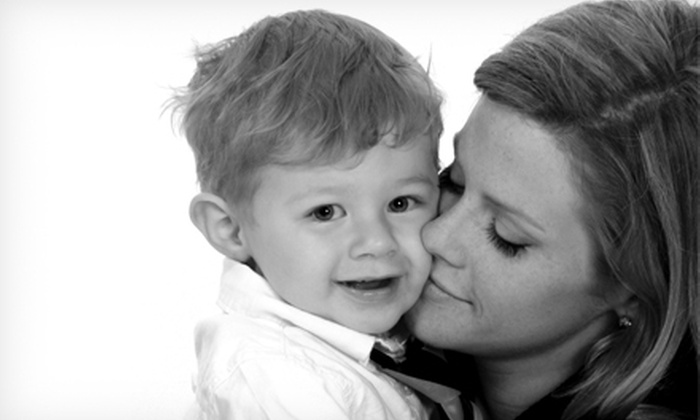 Sears Portrait Studio - Central City: $35 for a Deluxe Portrait Bundle with Photo Shoot, Image CD, and Prints at Sears Portrait Studio (Up to $184.91 Value)