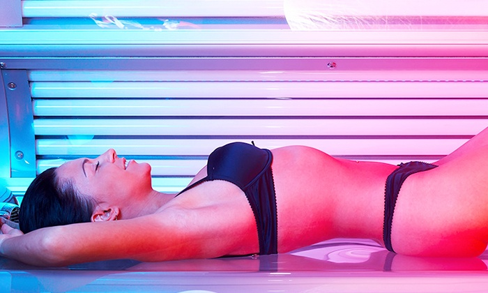 Catch A Ray Tanning Co. - Country Homes: $49 for One Month of Unlimited Red Light Therapy Sessions at Catch A Ray Tanning Co. ($99 Value)