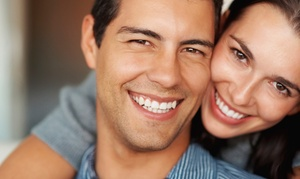 Pro White Teeth Whitening: $39 for a Teeth-Whitening Treatment at Pro White Teeth Whitening ($129 Value)