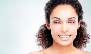 Unique Dental and Facial Clinic: Clear Braces For One Arch for £799 (68% Off)