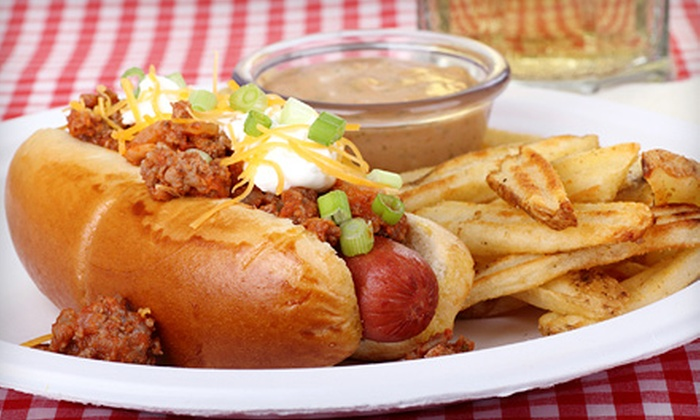 Pauly's Famous Franks N Fries - Multiple Locations: Gourmet Hot Dog Meals for 2 or 4, or a Two-Foot Long Hot Dog Challenge at Pauly's Famous Franks N Fries (Up to 57% Off)