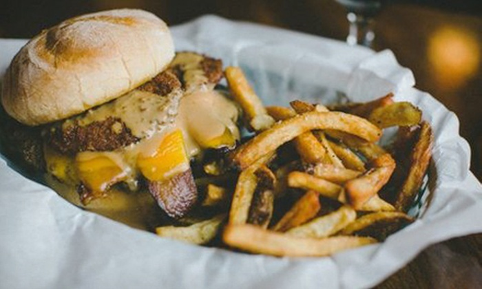 Four Pegs Beer Lounge - Germantown: Pub Fare for Two or Four at Four Pegs Beer Lounge (Half Off)