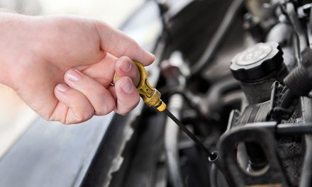 Oil-Change Package or AC Recharge for a Car or a Truck, Van, or SUV at Automotive Specialists (Up to 64% Off)