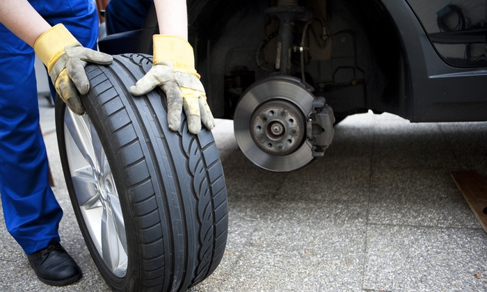Scott's U-Save - Central District: New Tires or Brake Pads and Rotors at Scott's U-Save (51% Off)