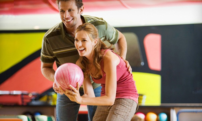 Jillian's - Peoria: $20 for Bowling Package for Four with Arcade-Game Cards and a Pitcher of Beer at Jillian's (Up to $49.99 Value)