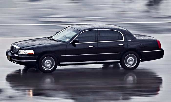 Border Limousine Service - Hudson: Roundtrip Airport Transportation in a Sedan or a Van or SUV from Border Limousine Service (Up to 54% Off)