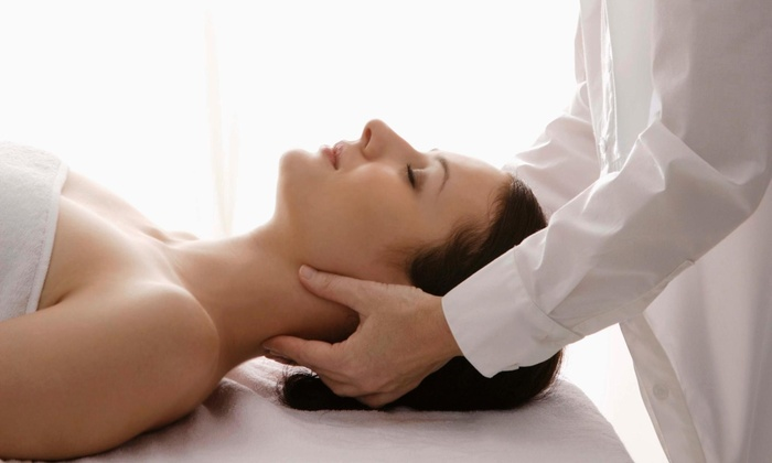 Giving Back Massage - Selden: 60-Minute Reiki Session with Aromatherapy from Giving Back Massage (55% Off)
