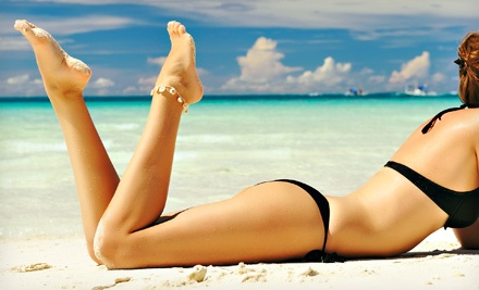 One or Three Airbrush Tans at Merle Norman (Up to 67% Off)