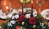 Charm's Floral of Asheville - Grace: Holiday Centerpiece, Fruit Basket, or Wreath, or One Dozen Roses from Charm's Floral of Asheville (Up to 58% Off)