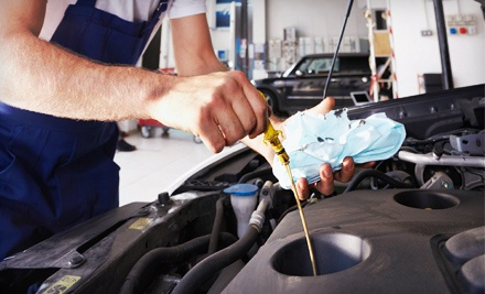 Spring/Summer Maintenance Package or Windshield-Washer Fluid with Unlimited Refills at Lube N Go Inc (Up to 56% Off)