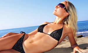 Caribbean Heat Tanning Salon: $8 for $16 Worth of Tanning at Caribbean Heat Tanning Salon