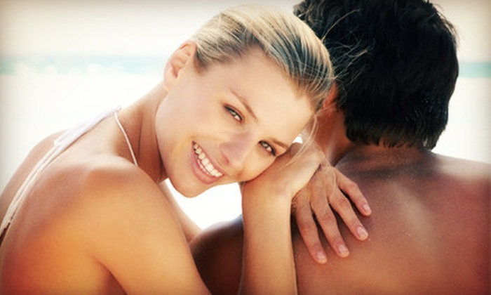 Bahama Breeze Tanning Salon - Greenfield: 2 or 5 Mystic Spray Tans, or 5 or 10 Level 2 or 3 UV Sessions at Bahama Breeze Tanning Salon (Up to 69% Off)