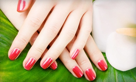 One or Two Pamper Me Manicures from Tammy Neuerburg at It's a Date at The Powder Room (Up to Half Off)