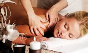 Donna Beseda, Licensed Massage Therapist at Trilogy Salon & Spa: Massage or Reiki Treatment Package with Donna Beseda, Licensed Massage Therapist at Trilogy Salon & Spa (Up to 54% Off)