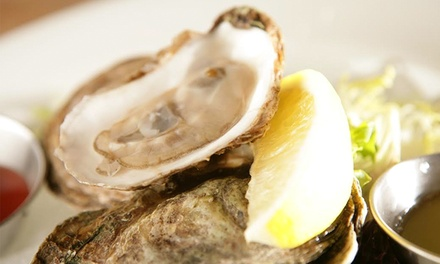 $50 or $100 Worth of Seafood and Drinks at King Crab Oyster Bar & Grill (50% Off)