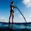 Surfing or Paddleboarding Lessons at Clint Carroll Surf School