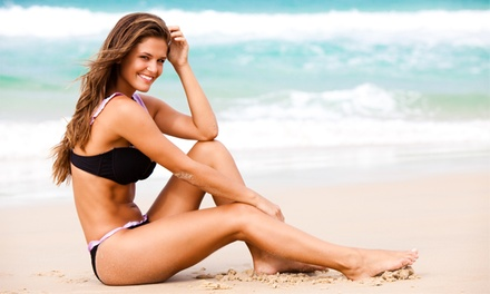 One Month of Unlimited UV Tanning or Two Airbrush Tans at Xtreme Tan (Up to $ Off)