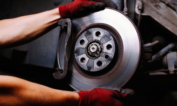 OK Tire - OK Tire 99th ST: Front and Rear Brake Service with Tire Rotation or Wheel Alignment at OK Tire (Up to 80% Off)