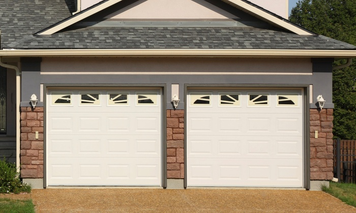 The Garage Door Co. of Boston - Boston: $59 for a Full-Service Garage-Door-Roller Tune-Up from The Garage Door Co. of Boston ($209 Value)