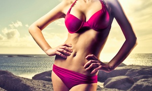 Planet Beach Contempo Spa: Three Mystic Spray Tans or One Month of Unlimited UV-Bed Tanning at Planet Beach Contempo Spa (Up to 48% Off)