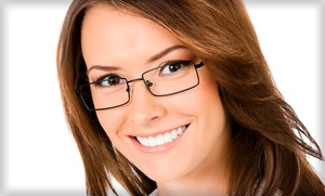 EyeShop Optical: Eye Exam and Credit Toward Prescription Glasses at EyeShop Optical (Up to 76% Off)