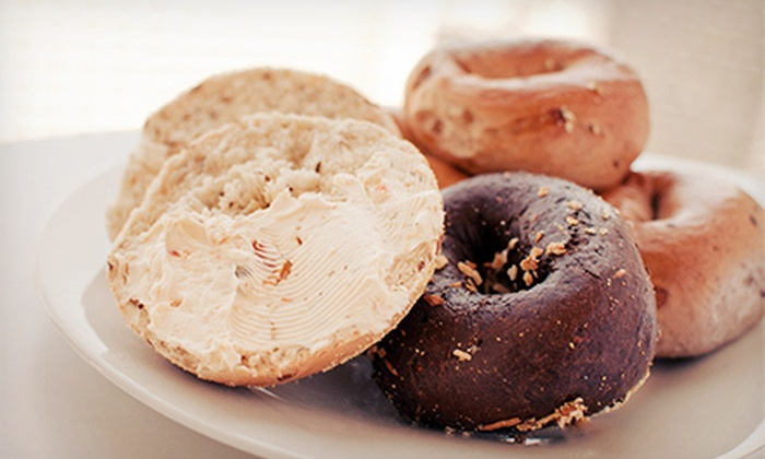 Bagel Club - Multiple Locations: $10 for One Dozen Bagels or Bagel Flats with Specialty and Plain Cream Cheese at Bagel Club (Up to $21 Value)