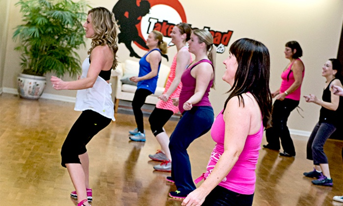 ZHealth - Multiple Locations: One Month of Unlimited Zumba Classes, or 4 or 10 Zumba Classes at ZHealth (Up to 53% Off)