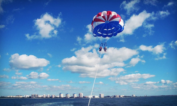 Estero Island Parasail - Multiple Locations: $75 for a Tandem Magnum Parasail Ride with Two Dips and One Commemorative Photo from Estero Island Parasail ($150 Value)