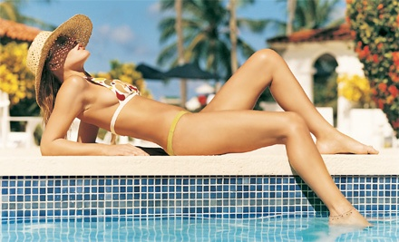 1 Month of Unlimited Tanning in a Superbed or Stand-Up Capsule or 1 or 3 Spray Tans at The Tanning Zone (Up to 51% Off)
