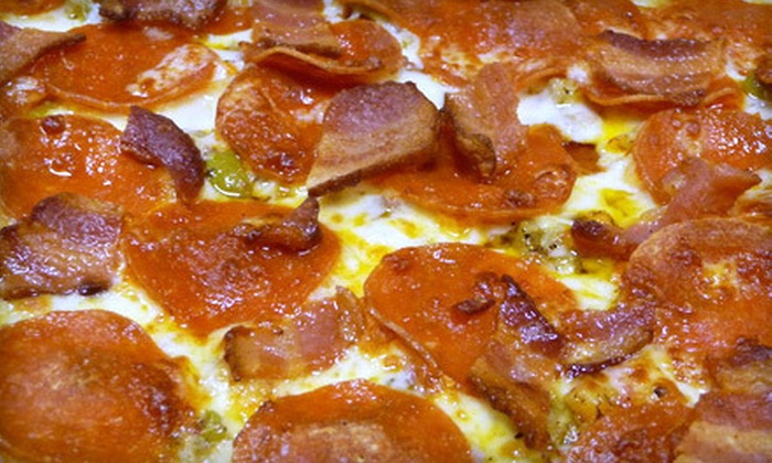 State Street Pizza - Near North Side: $14 for a Large Cheese or Pepperoni Pizza and a Large Salad at State Street Pizza ($28.49 Value). Two Options Available.