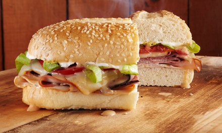 Two or Four Groupons, Each Good for $16 Worth of Sandwiches and Drinks at Momma Goldberg's Deli (50% Off)