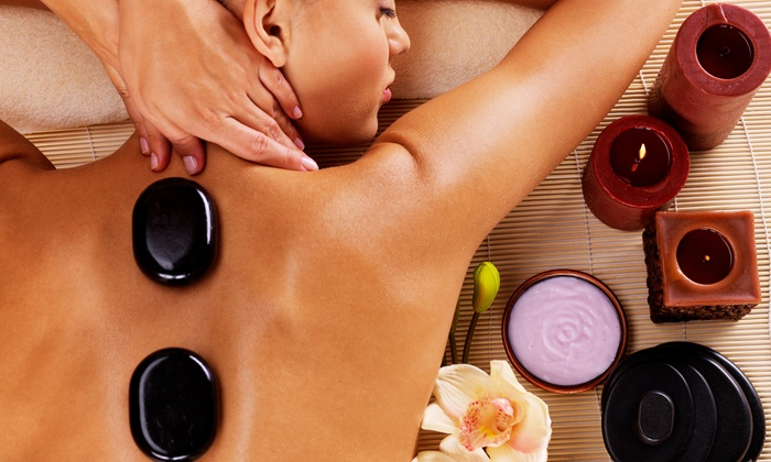 Tender Touch Massage - Garment District: One or Two Hot-Stone or Deep-Tissue Massages at Tender Touch Massage (Up to 54% Off)