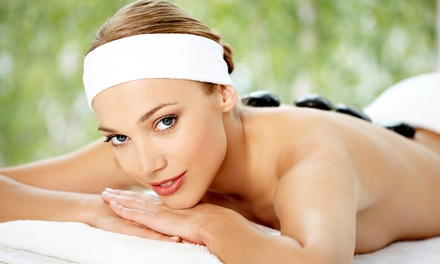 Massage or Couples Massage with Optional Hot Stones at The Concierge Spa (Up to 54% Off). Four Options Available.