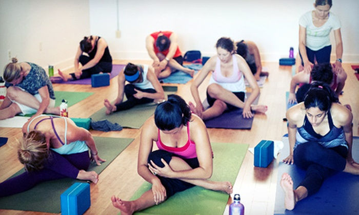 Invoke Yoga and Pilates Studio - Downtown Indianapolis: $59 for One Month of Unlimited Yoga, Pilates, or Barre Classes at Invoke Yoga and Pilates Studio ($139 Value)