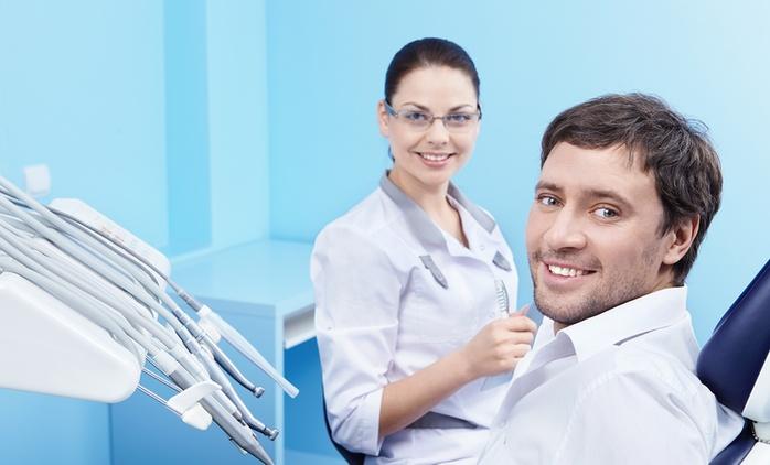 Visita odontoiatrica con pulizia dei denti e in più sbiancamento e otturazione
