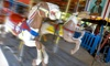 Kiddie Park San Antonio - Uptown Broadway: Unlimited Rides for Four Kids with Options for Two Popcorns or 50 Ride Tickets at Kiddie Park (Up to 64% Off)
