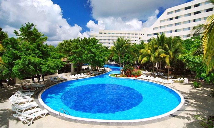 All-Inclusive Cancun Vacation with Airfare - Grand Oasis Palm: 5- or 6-Night All-Inclusive Cancun Vacation at Grand Oasis Palm with Airfare