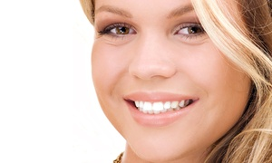 Utah Smile Clinic: $1,499 for a Dental Implant with Abutment and Crown at Utah Smile Clinic (Up to $3,465 Value)