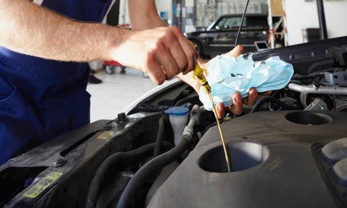 Minnoco - Minneapolis: $30 for Auto Inspection, Maintenance, and Wash Package at Minnoco ($131 Value)