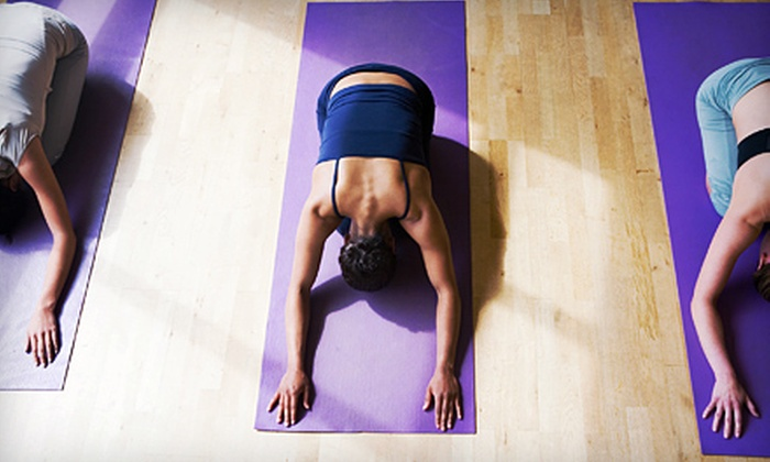 Portland Yoga Studio - Multiple Locations: 10 Group Yoga Sessions or 1 Private Session from Portland Yoga Studio (Up to 70% Off)