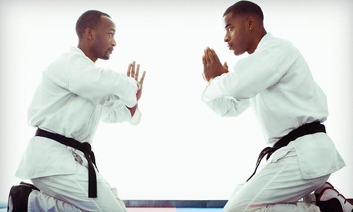 Queens Mixed Martial Arts - Auburndale: 4 or 10 Brazilian Jiu-jitsu Classes with Uniform and Belt at Queens Mixed Martial Arts (Up to 89% Off)