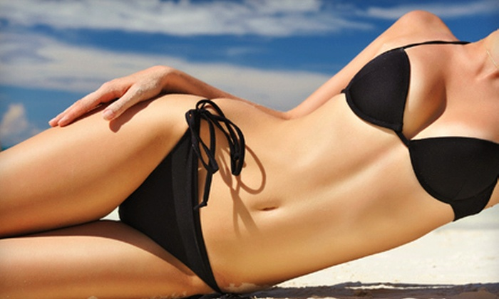 Midnight Sun - Cityview - Skyline - Fisher Heights: One or Two Spray Tans or 50 Tanning Points at Midnight Sun (Up to 72% Off)