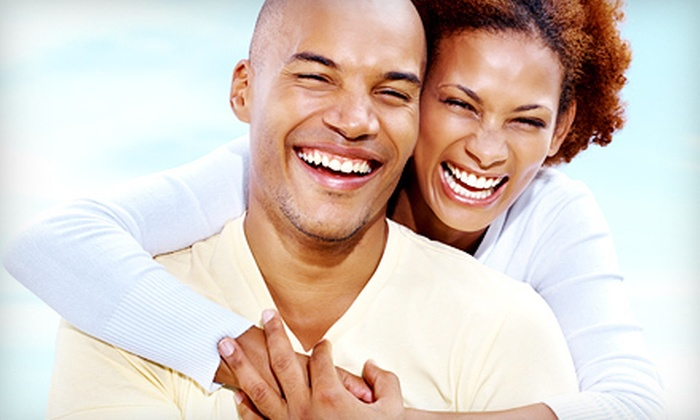 Henrickson Dental Clinic - Maplewood: Dental Implant Package for One or Two Teeth with Evaluation and X-rays at Henrickson Dental Clinic (Up to 64% Off)