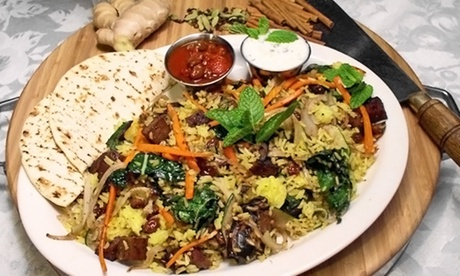 Vegetarian Cuisine and Drinks at Dharma's Restaurant (28% Off). Two Options Available.