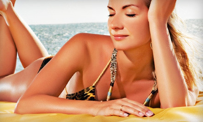 Sun City Tanning - Pleasant Hill: One, Three, or Five Custom Airbrush Tans or Month of Unlimited Tanning-Bed Sessions at Sun City Tanning (Up to 66% Off)
