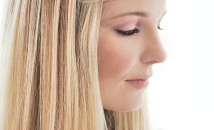Express Blowout and Style or Natural Keratin Smoothing Treatment at Salon Aura (Half Off)